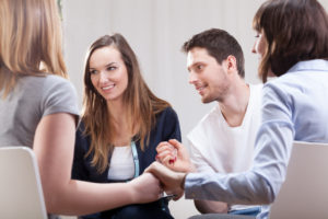 Lighthouse Treatment Center how to cope with losing someone to addiction people in group therapy