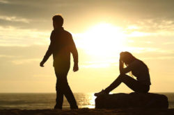 lighthousetreatment-how-to-detach-from-an-addict-with-love-article-photo-couple-silhouette-breaking-up-a-relation-on-the-beach-at-sunset-254876533