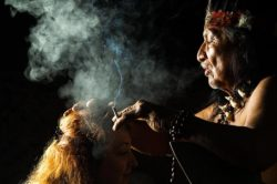 lighthousetreatment-what-is-ayahuasca-article-photo-shaman-in-ecuadorian-amazonia-during-a-real-ayahuasca-ceremony-model-released-image-as-seen-in-268016867