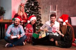 lighthousetreatment-how-to-stay-sober-and-have-fun-over-the-holidays-article-photo-picture-showing-group-of-friends-with-christmas-presents-on-party-at-home-761975707
