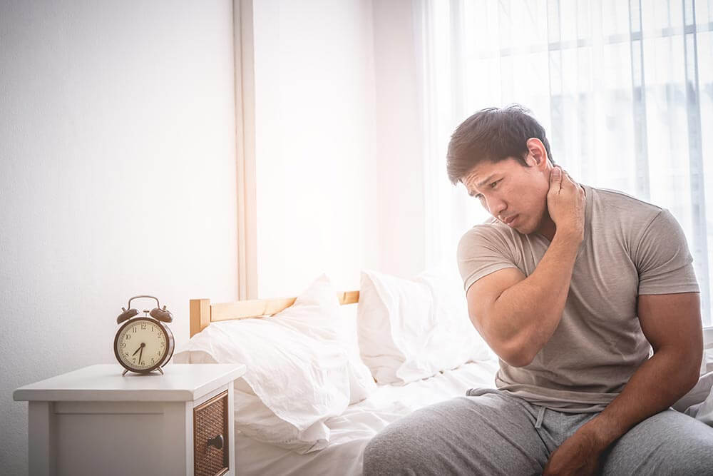 lighthousetreatment-how-long-does-alcohol-detox-take-and-what-happens-article-photo-male-woke-up-by-having-muscle-pain-in-the-neck-1075336850