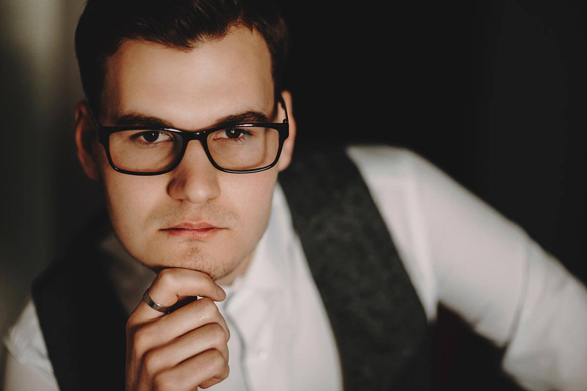 lighthousetreatment-the-relation-between-iq-and-drug-addiction-article-photo-closeup-portrait-of-young-businessman-wearing-glasses-and-looking-at-camera-1065320855