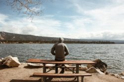 lighthousetreatment-what-is-monastic-addiction-treatment-article-photo-man-overlooking-bear-mountain-lake-in-california-583010608