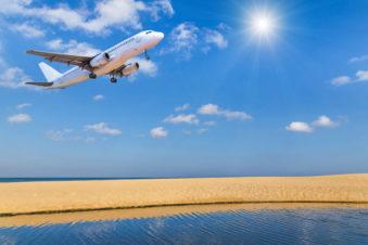 lighthouse-treatment-image-of-plane-landing-over-beach-541135675