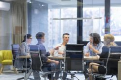 lighthousetreatment-effects-of-marijuana-use-in-the-workplace-article-photo-group-of-a-young-business-people-discussing-business-plan-at-modern-startup-office-building