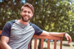 lighthousetreatment-long-days-and-nights-how-to-stay-sober-over-the-summer-article-photo-young-man-relaxing-on-park-bench-on-a-summers-day