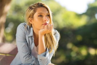 lighthousetreatment-8-tips-make-it-through-first-days-clean-and-sober-article-photo-thoughtful-woman-sitting-alone-outdoors